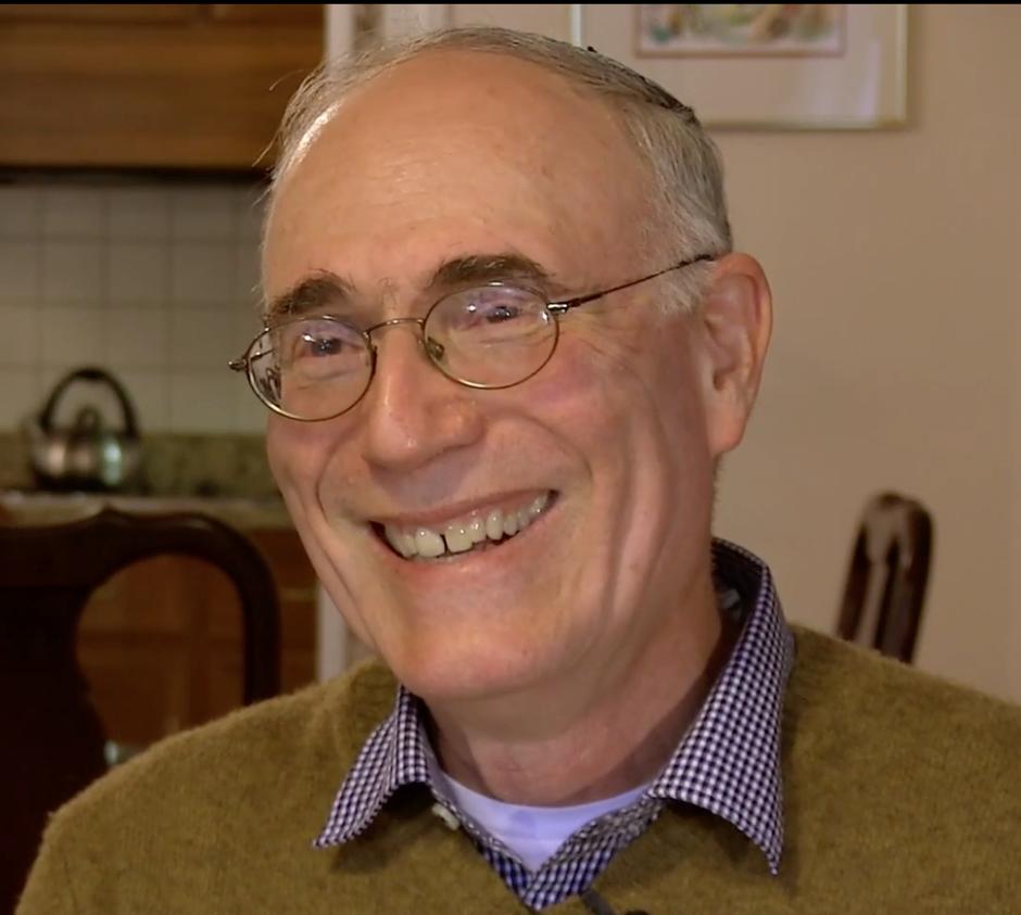 Screenshot of headshot of George Johnson from video
